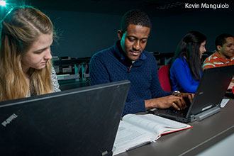 Liberty University computational sciences students study together.