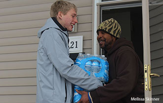 A Liberty student delivers water in Flint, Mich.