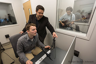 Liberty University students and a professor hold a recording session in one of the new songwriting labs on campus.