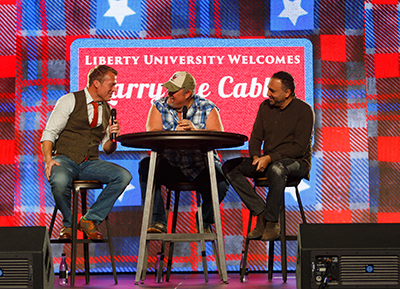 Recording artist Charles Billingsley (left) and Liberty's Senior Vice President for Spiritual Development David Nasser (right), talk with Dan Whitney as he sheds his Larry the Cable Guy persona.