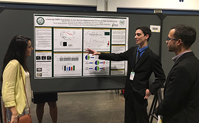 Misla David presents his research poster at the ABRCMS on Friday, Nov. 11.