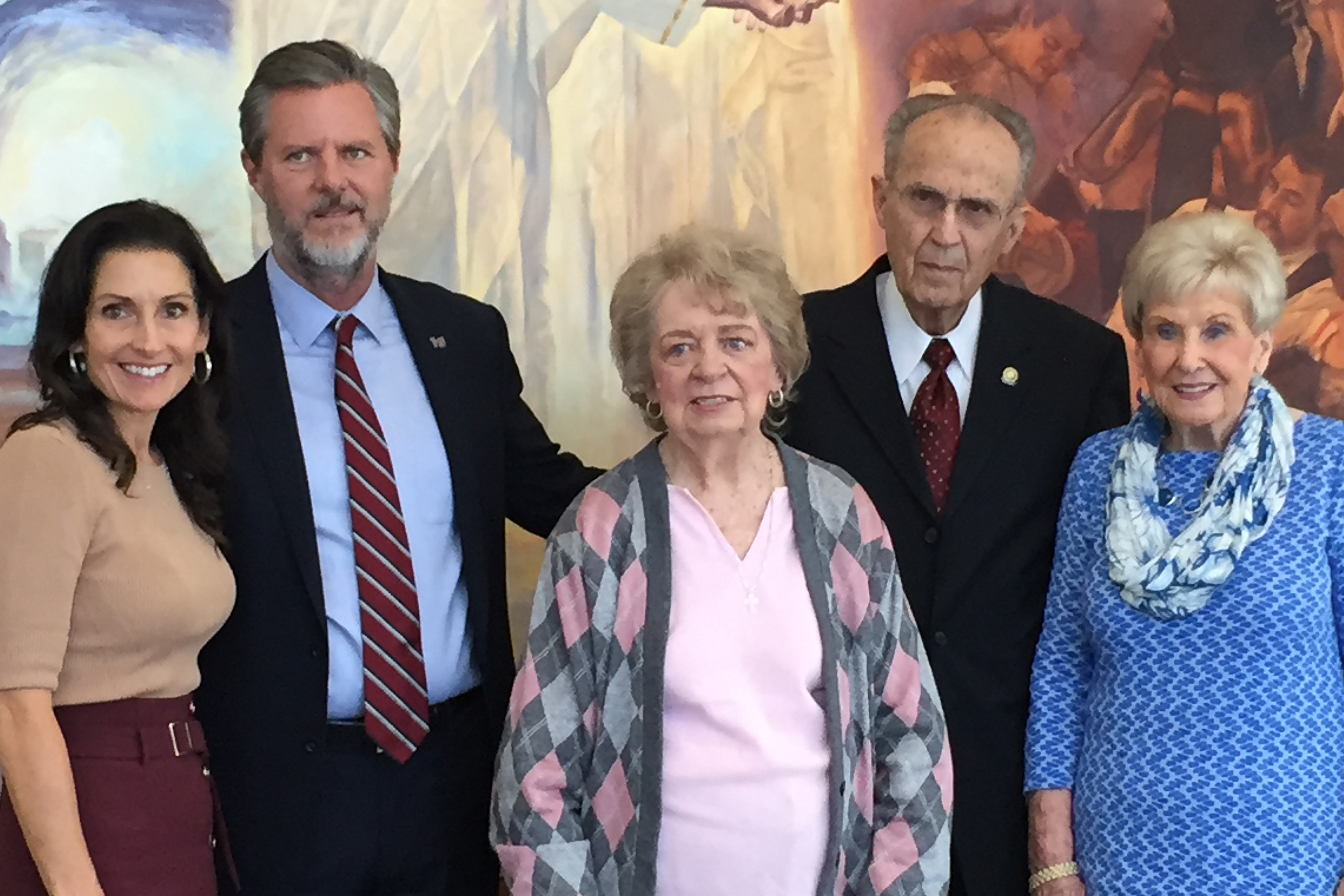 President Jerry Falwell and his wife, Becki, stand with donors Rebecca Thigpen Coulter and Dr. Troy L. Day and Day's wife, Pauline, in front of a painting of the Resurrection of Christ.