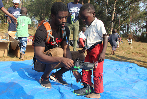 Emmanuel Ntibonera delivers shoes to children in his homeland. (Photo by Christian Ntibonera)
