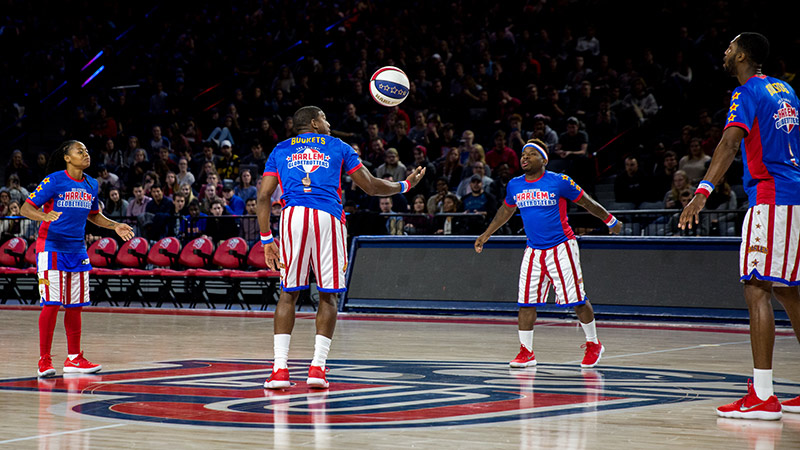 The Globetrotters form their 'Magic Circle' at center court in the Vines Center. (Photo by Andrew Snyder)