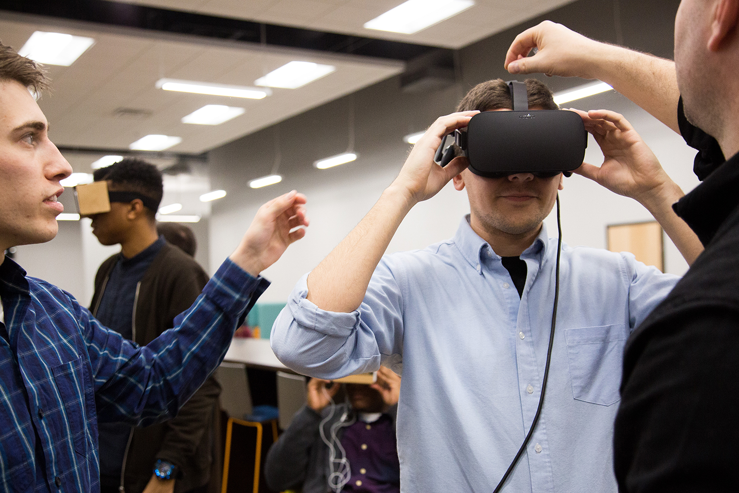 Senior digital media student Jeremie Grandemange tries on a VR headset. (Photo by Leah Seavers)