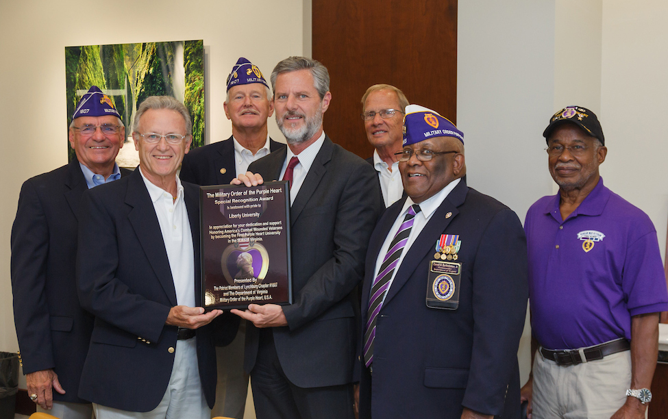 Liberty University President Jerry Falwell receives a plaque from local veterans and representatives of the Military Order of the Purple Heart on Thursday.