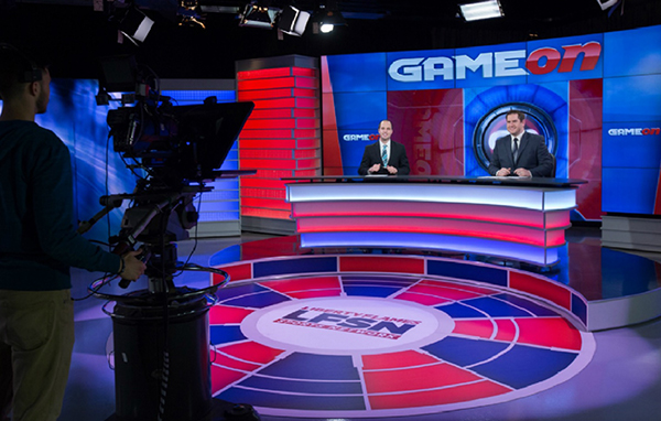 LFSN co-anchors Matt Warner (left) and Rett McGibbon work on the set of 'Game On,' Liberty University's weekly sportscast.