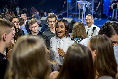 Candace Owens interacts with Liberty University students following Convocation on Wednesday in the Vines Center.