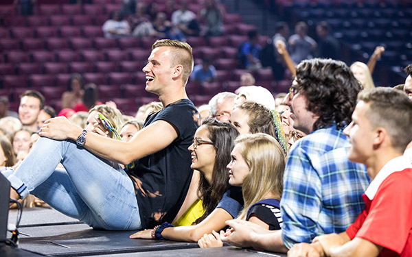 Steele Johnson poses with Liberty University students following Friday morning's Convocation. (Photo by Nathan Spencer)