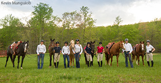 Members of Liberty University's equestrian team pose with their horses in April.