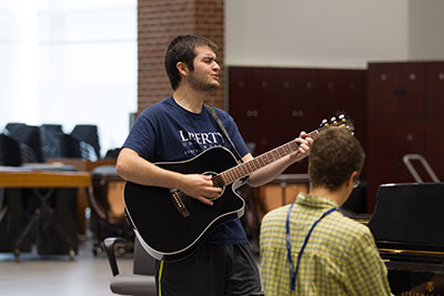 Guitar and piano players rehearse during the School of Music's Music and Worship Camp.