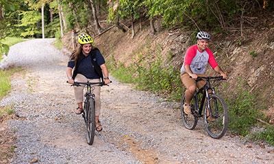 Hydaway Outdoor Recreation Center staff members test out the mountain bikes on the path that goes around Hydaway Lake. (Photo by Kaitlyn Becker Johnson)