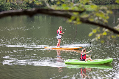 Liberty University students try out the kayaks and stand-up paddleboards available for use in the lake at the Hydaway Outdoor Recreation Center. (Photo by Kaitlyn Becker Johnson)