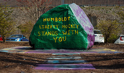 Club Sports staff painted Liberty University's spirit rock after Tuesday's prayer vigil. (Photo by Leah Seavers)