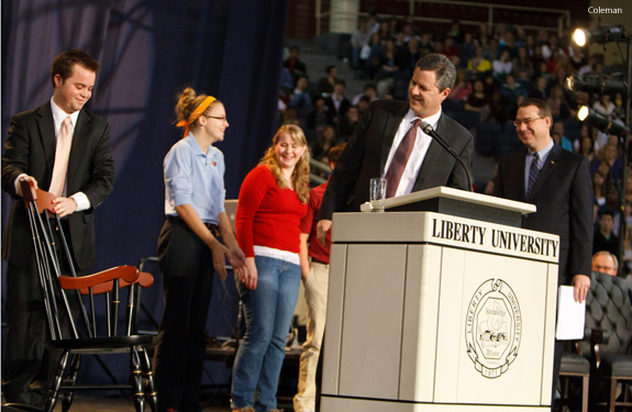 Jerry Falwell Jr presents rocking chair to former senior campus pastor Dwayne Carson