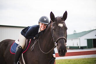 Kendall Burdette, a rising senior captain on Liberty's Hunt Seat equestrian team, has fallen in love with riding again since rededicating her life to the Lord. (Photos by Leah Seavers)
