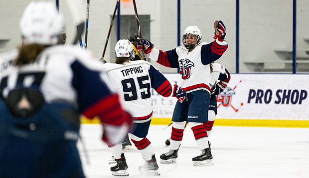 Lady Flames junior forward Aly Morris celebrates a goal with graduate defenseman C.J. Tipping in a recent game at the LaHaye Ice Center. (Photo by Luke Bobbey)  test test test test