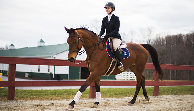 Lady Flames junior Amber Gayheart practices on the outdoor ring at the Liberty Equestrian Center. (Photo by Leah Stauffer) test test test test