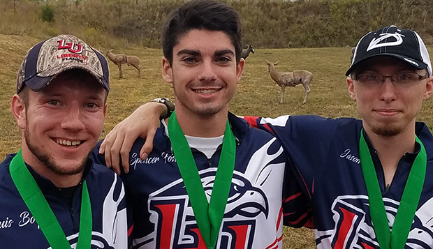 Senior Louis Boyd (left) and graduate students Spencer Foster and Jason Lynch combined to capture the men's bowhunting team title at last fall's USCA 3D National Championships. test test test test