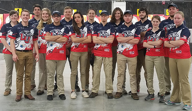 Liberty Head Coach Ian Rigney (back right) took 14 archers to Kentucky, the most to travel to a shoot in program history. test test test test