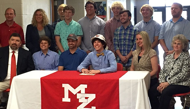 Mt. Zion High School senior Ashton Robinson (center) signs his national letter of intent to compete at Liberty starting next fall. test test test test