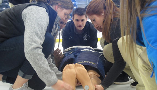 Athletic training students practice moving a manikin from the rink at the LaHaye Ice Center on Sunday afternoon.