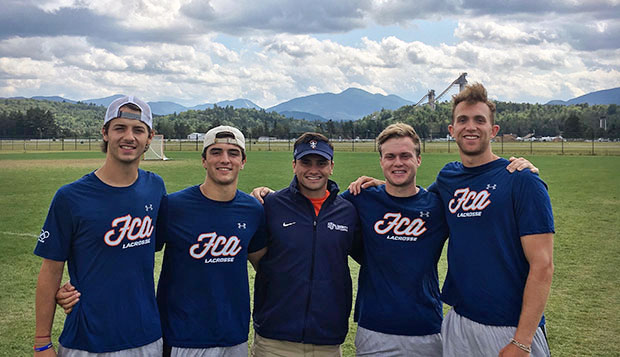 Liberty Assistant Coach Brett Bernardo (center) is serving with FCA Lacrosse in Israel this week with fellow former Flames midfielder Brett Miller (right), who graduated in May. test test test test