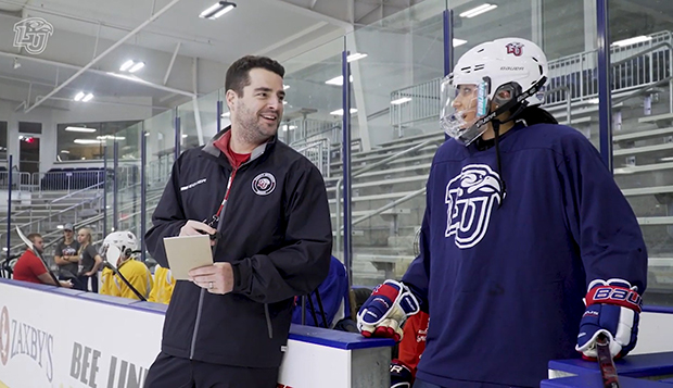 LFSN sideline reporter Bhrett Vickery chats with Lady Flames ACHA DI women's hockey Head Coach Chris Lowes at practice. test test test test