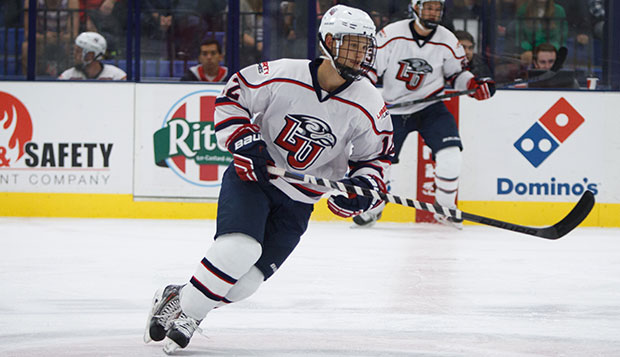 Christian Garland played forward for the Flames' Division I men's hockey team from 2011-15 and the DII squad from 2015-16. test test test test