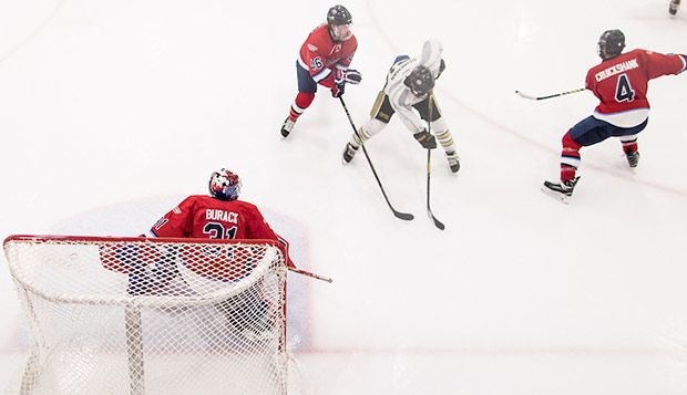 Junior goalie Cole Burack made 16 saves, stopping at least four breakaways and a flurry of shots early in the third period, to post his fifth shutout for the Flames. (Photo by Joel Isimeme) test test test test