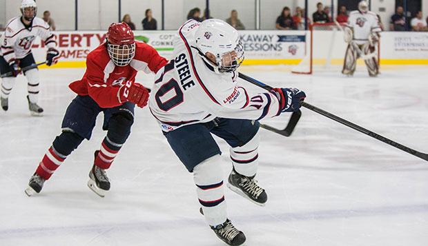 Liberty sophomore forward Colt Steele battles against the Potomac Patriots in last year's opener at the LaHaye Ice Center. test test test test
