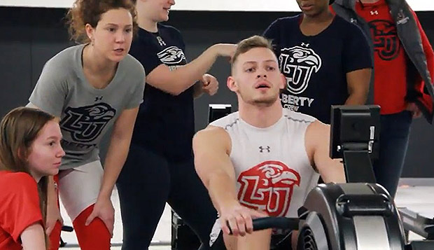Flames rower Spencer Barrett practices on one of the ergs set up in Liberty's indoor training facility. test test test test
