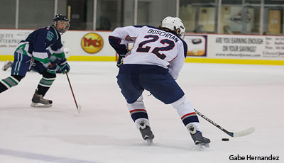 Jeff Boschman (#22) makes a move on the ice for the DII Flames. Liberty beat the Hampton Jr. B Whalers handily twice over the weekend.