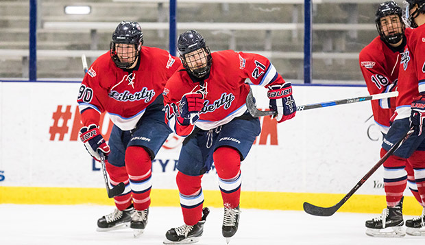 Freshmen forwards Cole Gammer (left), Devin Pierce, and Jordan Bochinski have formed one of the Flames' most effective lines in recent games. (Photo by Joel Isimeme) test test test test