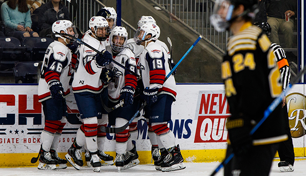 Liberty players, including seniors (from left) Garrett Nelson (46), Cody Clarke (96), Josh Hamilton (8), and Quinn Ryan (19), celebrate a goal against Adrian. (Photo by Chase Gyles)  test test test test