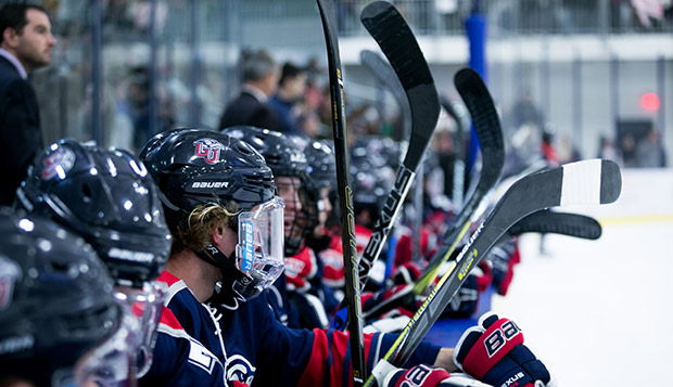 Liberty Head Coach Kirk Handy watches over players holding sticks as they wait to get into Friday night's 'Midnight Mayhem' game vs. IUP at LaHaye Ice Center. (Photo by Nathan Spencer)  test test test test