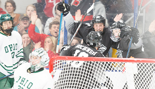 Liberty junior forwards Jordan Bochinski and Cole Gammer and senior defenseman Chaydan Lauber celebrate Lauber's first-period goal behind the Bobcats' cage. (Photos by Luke Bobbey)  test test test test