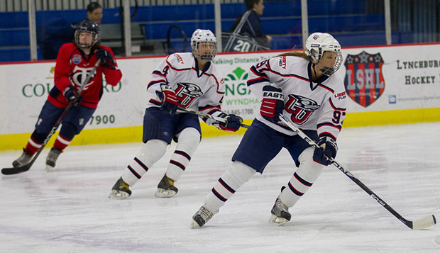 Liberty sophomore forward Sarah Fowler (97) and junior forward Stephanie St. Amand (4) skate in last weekend's game at the LaHaye Ice Center. test test test test
