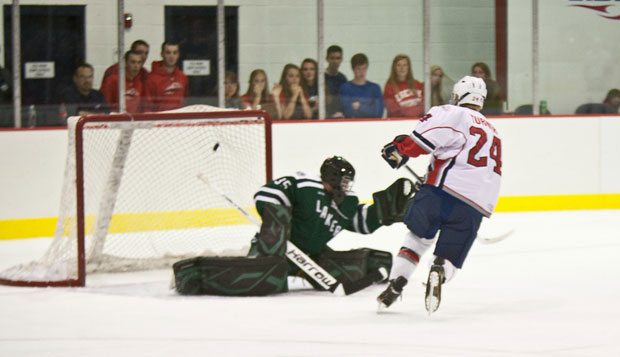 Rick Turner (#24) attacks the Mercyhurst goalkeeper in the Flames 8-2 win Friday night. test test test test
