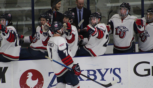 Junior forward Blake Flanders celebrates along the Flames' bench at the LaHaye Ice Center, where Liberty will host Rowan this Friday and Saturday afternoon. (Photos by Ted Allen) test test test test