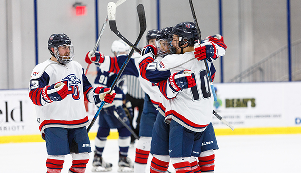 Liberty ACHA DII men's hockey players celebrate a goal in a recent game at the LaHaye Ice Center. (Photos by KJ Jugar) test test test test