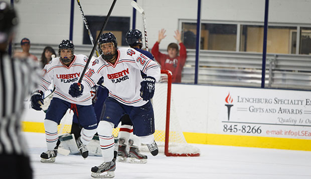 Liberty junior forward Kaleb Shannon celebrates a goal in a game played at the LaHaye Ice Center last season. test test test test