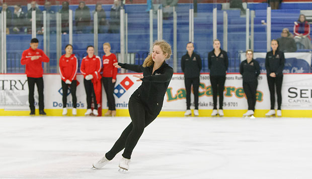 Rebekah Hicks competes for Lady Flames in a Team Maneuvers event at last spring's Intercollegiate Competition at the LaHaye Ice Center. test test test test