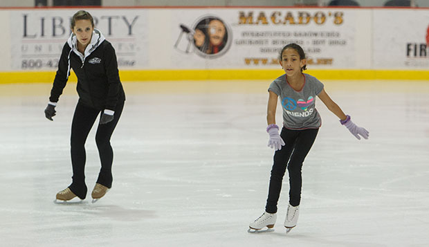 Liberty figure skating head coach Tatiana Payne (left) guides a young skater through a freestyle workout Tuesday at the LaHaye Ice Center.  test test test test