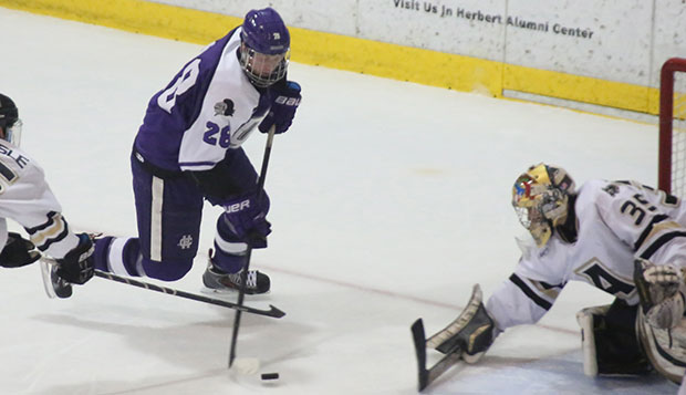 Grant Garvin looks for a shot as he maneuvers the puck through the crease in an NCAA Division I game last season.   test test test test