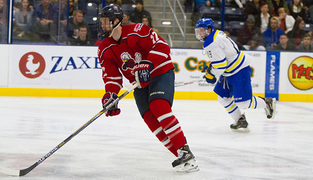 Flames junior forward Grant Garvin starts a fast break in Saturday's opener against Delaware at LaHaye Ice Center. test test test test