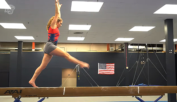 Lady Flames freshman Shea Whitehurst practices the balance beam at the gym in The Plaza. (Photo by Patrick Strawn) test test test test