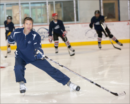 Follow me— Liberty University uses hockey as a medium to minister to athletes during the summer. Above, Liberty DI assistant hockey coach Jeff Boettger demonstrates good backpedal technique. Photo credit: Les Schofer