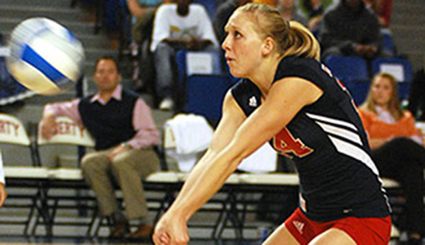 Jessica Nelson makes a dig during a match with Liberty's NCAA Division I indoor women's volleyball team in the mid-2000s. test test test test