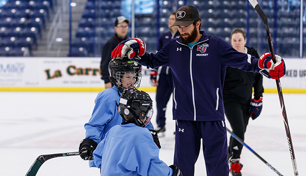 Josh Hamilton works with two of the 6-9-year-old Squirts and Mites players during Wednesday afternoon's on-ice session at the LaHaye Ice Center. (Photos by KJ Jugar)  test test test test